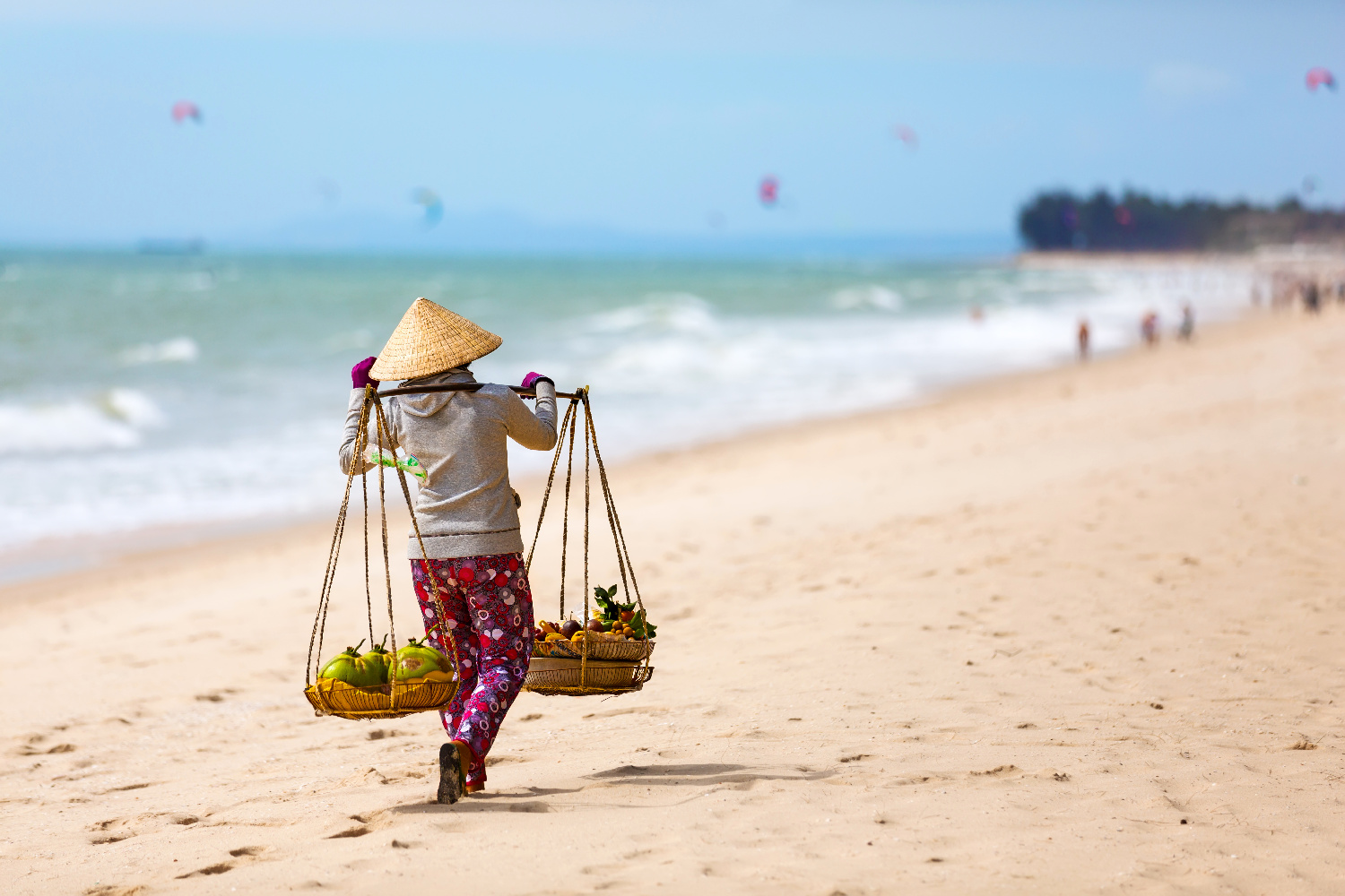 Vietnamese woman selling Fruits at Mui Ne beach. Vietnam